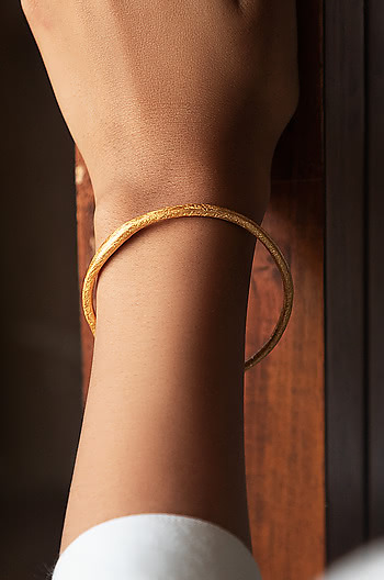 Kerry W Bangle in Gold plating